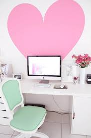 love the oversized pink heart white walls white desk mint