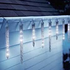 christmas icicle lights northern lights and trees