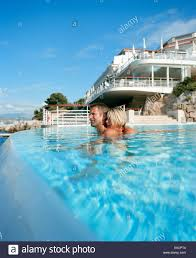 Hotel Du Cap Eden Roc Couple Swimming In The Overflow Swimming Pool Underneath The Eden