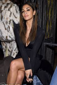 nicole s nicole scherzinger shows off her cleavage in a plunging black gown