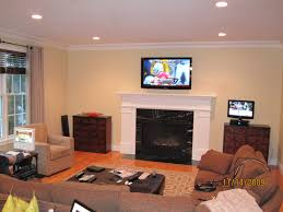 hanging tv above fireplace enter image description here best 25