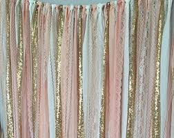 wedding backdrop garland shades of gold sequin lace ribbon sparkle wedding backdrop