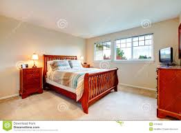 warm colors bedroom with wood furniture stock image image 37508855