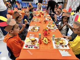 meyer school pre k kindergarteners sit to early thanksgiving