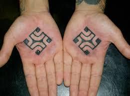 swastika swastika tattooed hands