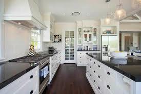 Fancy White Kitchen Cabinets With Black Countertops Wood Floor - White cabinets dark floor bathroom