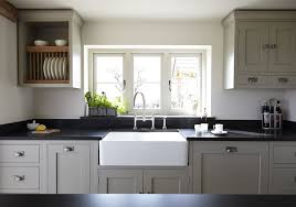 grey kitchen units with black granite worktops shaker style kitchen with bespoke plate rack and wall