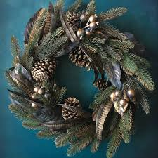gold cone and feather christmas wreath by the christmas home