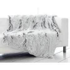 plaid de protection canapé plaid de canape plaid polaire blanc canape beige dans le salon plaid
