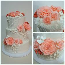 coral wedding cakes coral ivory iced 3 tier cake wedding tiered