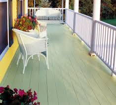 vintage porch deck with bright green color deck paint and blue