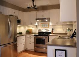 White Paint Kitchen Cabinets by Kitchen Cabinets White Paint Dark Greyish Countertops Greige