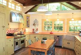 traditional kitchen with mexican tile backsplash by harvest