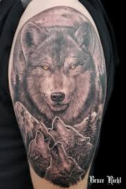 black and grey wolf shoulder by bruce riehl tattoos by