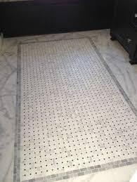 stunning bathroom floor composed of marble basketweave tiles and