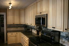 pictures of kitchens with oak cabinets and black countertops