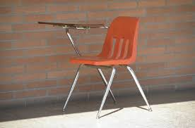 desk with attached chair suspensions of students with disabilities slide33