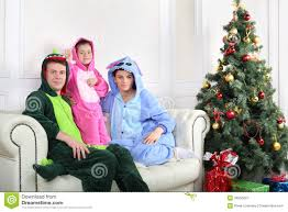 Mother Daughter Christmas Ornaments Father Mother And Daughter Sit On Sofa Near Christmas Tree