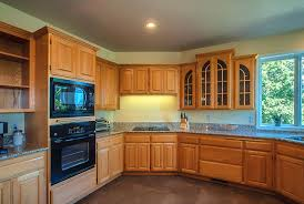 What Color To Paint Kitchen Cabinets by Kitchen Colors With Oak Cabinets And Black Countertops Wallpaper