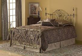georgian wrought iron bed frame with elegant grey carpet for