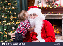 the christmas wish santa claus and child boy kid telling his christmas wish