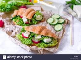 croissant sandwich with cheese and vegetables for healthy snack