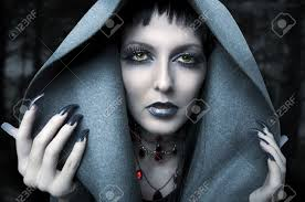 halloween fashion portrait of witch or night vampire woman