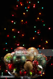 ornaments in glass bowl with lights in