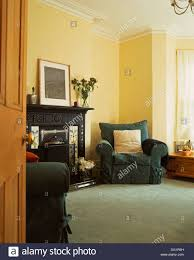 dark green loose covers on armchairs in traditional living room