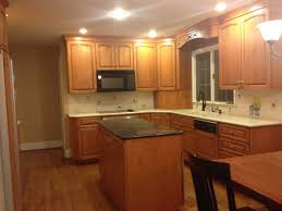 are wood kitchen cabinets outdated the before kitchen had outdated subway tile and wood