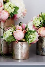 peonies in an aged silver vase pink