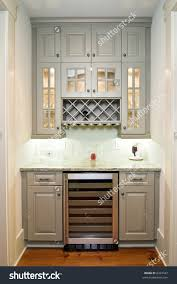 butlers pantry with wine rack cabinets and wine refrigerator