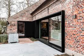 residential sliding glass doors synergy of contrasting styles farmhouse renovation in belgium