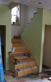 Laminate Flooring Around Stairs Stair Example With Separating Wall Wilmington Thoughts