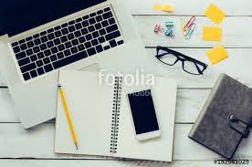 floor in laptops accessories notebook is placed on a wooden floor in the