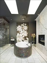 bathroom decor ideas with wall art and fireplace and flower vase