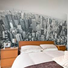 teen bedroom cityscape wallpaper with wooden bed frame and side