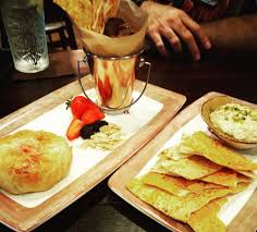 Hummus Kitchen Appetizers On The Right Pistachio Hummus On The Left Baked Brie