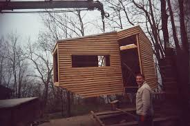 House Plans On Stilts by Tiny Wooden Cabin On Stilts Is A Cozy Escape In The Trees H06