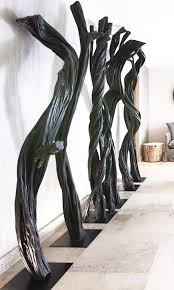foyer haunting sculptural trees fill this foyer in luxury