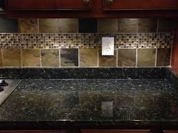 updated shot of the verde butterfly granite countertops and slate