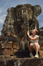 pamper this elephant statue at east mebon temple angkor