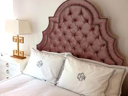 pink velvet tufted headboard with brass tacks transitional bedroom
