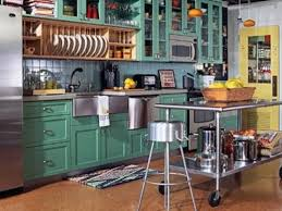 small one wall kitchen with moveable island with seating one