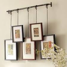 Picture Frame Hanging Ideas Here U0027s A Rather Unique Idea For A Gallery Wall Of Stacking Frames