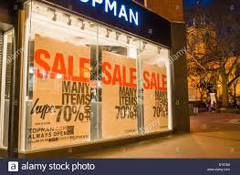 window posters sale posters in topman retail shop window at stock photo