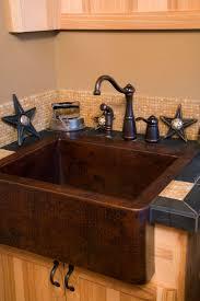 dark farmhouse sink oil rubbed bronze fixtures glass tile