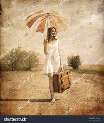 lonely suitcase umbrella country road stock photo 77343286