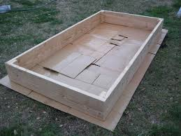 tutorial for building a raised vegetable garden cardboard under to