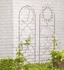 handmade metal garden trellis with celestial design arbors